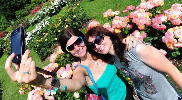 Gillian Whyte and Danielle Graham pictured enjoying the great weather at Rose Week. Picture By: Arthur Allison.