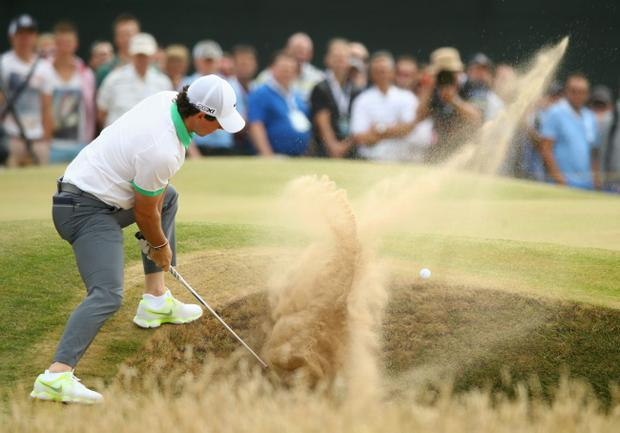 GULLANE, SCOTLAND - JULY 18: Rory McIlroy of Northern Ireland hits out of a bunker on the 5th hole during the first round of the 142nd Open Championship at Muirfield on July 18, 2013 in Gullane, Scotland. (Photo by Matthew Lewis/Getty Images)