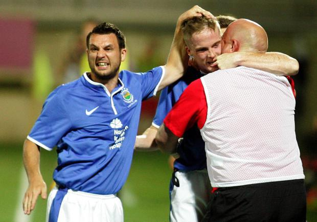 James Ervin(L) with Aaron Burns(c) and Jeffrey David (r) FC Linfield coach celebrate first goal. FC Skoda Xanthi v FC Linfield UEFA Europa League 2nd leg qualifiers in Xanthi, Greece. Photo by Aleksandar Djorovic/Press Eye