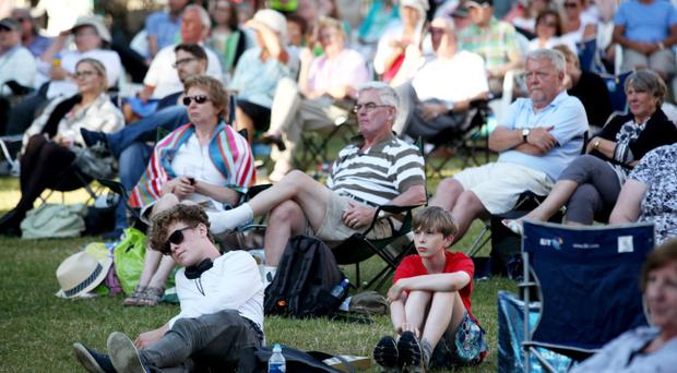 18.07.13. A huge crowd gathered in the Belfast City Hall grounds to watch 'Tosca' the Opera live on the big screen. Picture David Fitzgerald