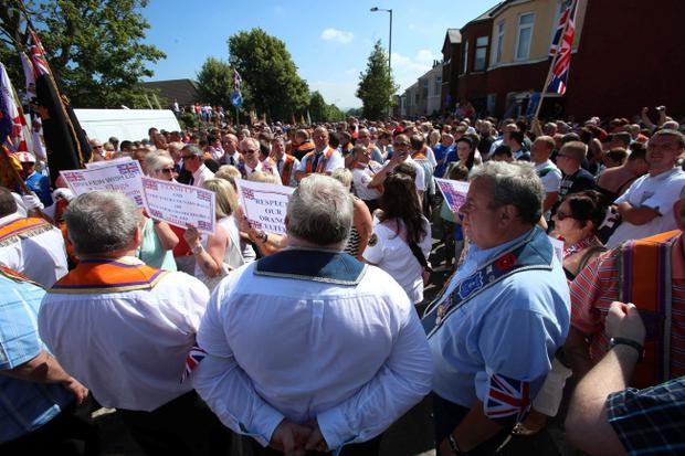Orangemen during a stand-off with police on Woodvale Road, Belfast, close to the Ardoyne, after their protest march was re-routed by the Parades Commission