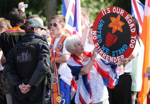 The figure includes daily costs of over £40,000 to police a loyalist protest camp at the Twadell Avenue interface in Belfast