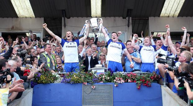 Monaghan vs Donegal Monaghan captain Owen Lennon lifts the cup with Conor McManus