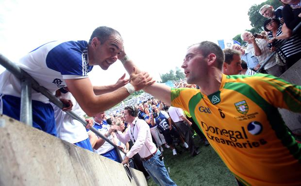 Monaghan vs Donegal Monaghan's Paul Finlay with Karl Lacey of Donegal after the game