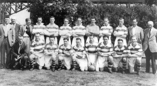 The Belfast Celtic team which toured the USA in 1949 - Back Row, Elisha Scott, Dan McSparran, Robin Lawler, Joe Douglas, Jimmy Murdough, Mick O'Flanagan, Billy McMillan, Kevin McAliden, Charlie Currie, Reggie Simpson, Patsy McAliden, Austin Donnelly (chairman); Front Row: Paddy McGuigan (trainer)Alex Moore, johnny Campbell, George Hazlett, Jackie Denver (5th from LEFT), Harry Walker, Tommy Aherne, Paddy Bonnar, Tom Dorman.
