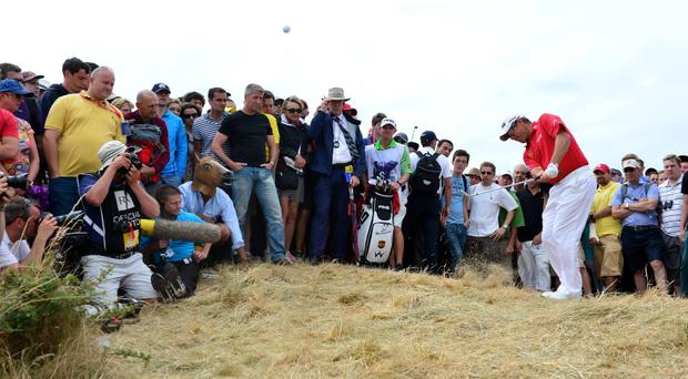 England's Lee Westwood hits out the rough during day four of the 2013 Open Championship at Muirfield Golf Club, East Lothian.