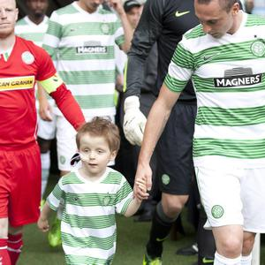 Presseye Northern Ireland - 23 July 2013 Mandatory Credit - Photo - Rob Hardie/ Presseye Oscar Knox with Celtic skipper Scott Brown during Tuesday evenings Celtic v Cliftonville Champions League, 2nd qualifying round, 2nd leg match at Parkhead, Glasgow Scotland