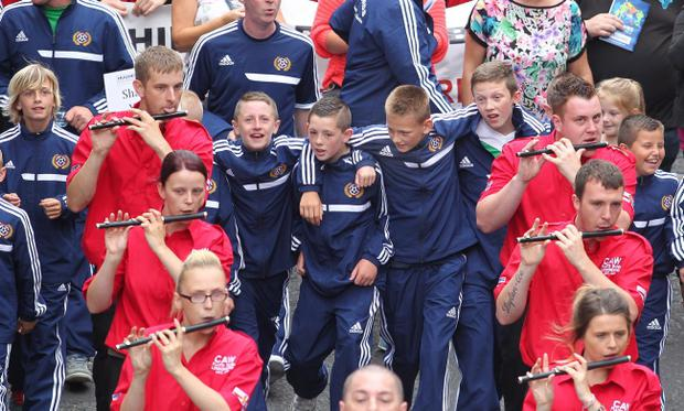 Foyle Cup 2013 23-7-13 The Foyle Cup parade of players taking place in Derry on Tuesday morning. thousands of young players and their families from across the UK and abroad are taking part in the 2013 event with matches taking place across the North West. Picture Margaret Mclaughlin ? by-line