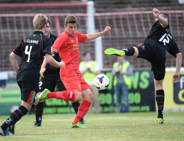Pre season friendly match between Glentoran and Liverpool under 21's at The Oval Belfast. Glentorans Richard Clarke in action with Liverpools Adam Morgan