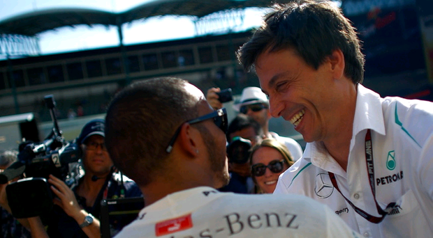 Lewis Hamilton of Great Britain and Mercedes GP is congratulated by the Mercedes GP Executive Director Toto Wolff