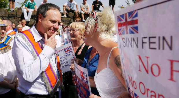 Nigel Dodds MP with Orange supporters pictured on the Woodvale Road in Belfast afternoon during a protest march up to the police lines. Order members have continued to hold protests in the area throughout the week. Picture by Kelvin Boyes / Press Eye.
