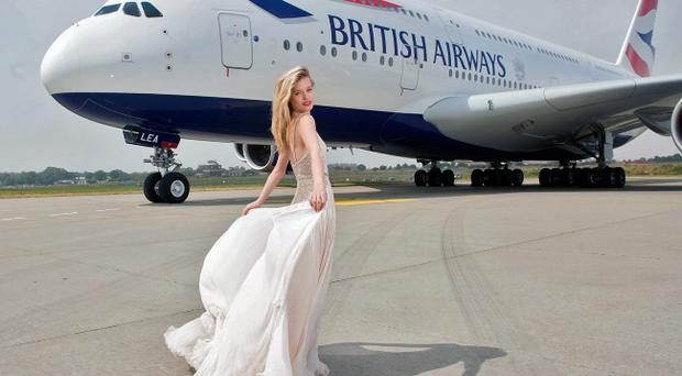 Georgia May Jagger in front of the new British Airways A380 double decker aircraft (Photo by Bethany Clarke/Getty Images for British Airways)