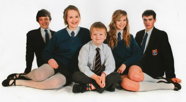 Aaron Macaulay (centre), who died in a farming accident in Northern Ireland, pictured with his siblings (left to right) Jack, Helen, Hazel and Matthew. Photo PA.