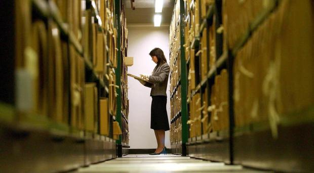 A researcher from the National Archives Office retrieving a document. The release by the National Archives of government files from 1983 marks the start of the transition to releasing files after 20 years.