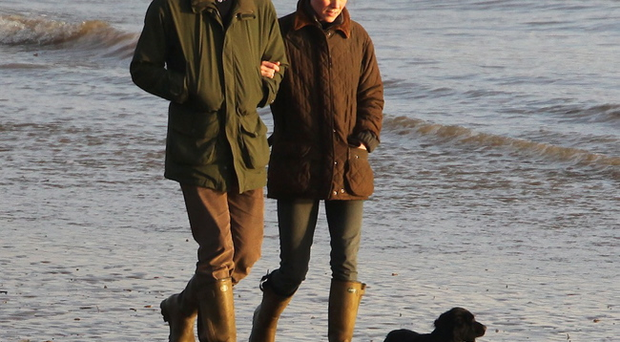 Kate and William on a stroll with their black Cocker Spaniel puppy Lupo