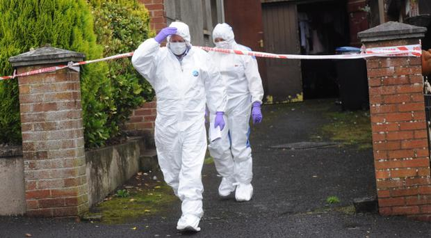 Forensics at the scene after a man died after a stabbing at Woodvale Drive area of Dungannon in Co Tyrone. Pic Colm Lenaghan/Pacemaker
