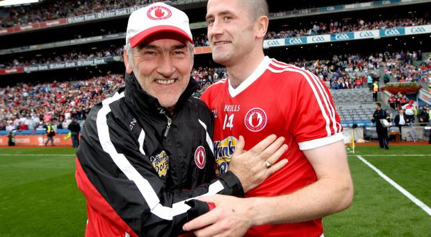 Tyrone manager Mickey Harte and Stephen O'Neill celebrate victory over Monaghan