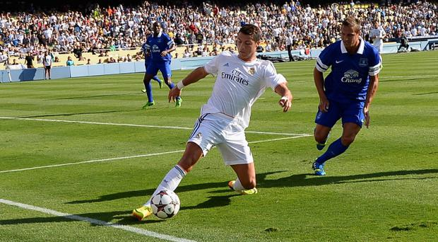 LOS ANGELES, CA - AUGUST 03: Cristiano Ronaldo #7 of Real Madrid saves the ball from going out of bounds as defender Philip Jagielka #6 of Everton looks on during the fist half of the 2013 Guinness International Champions Cup at Dodger Stadium on August 3, 2013 in Los Angeles, California. (Photo by Kevork Djansezian/Getty Images)