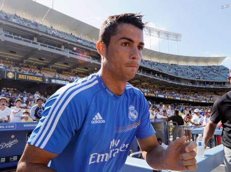 LOS ANGELES, CA - AUGUST 03: Cristiano Ronaldo #7 of Real Madrid enters the field from the Los Angeles Dodgers dugout prior to the start of the soccer match against Everton in the 2013 Guinness International Champions Cup at Dodger Stadium on August 3, 2013 in Los Angeles, California. (Photo by Kevork Djansezian/Getty Images)
