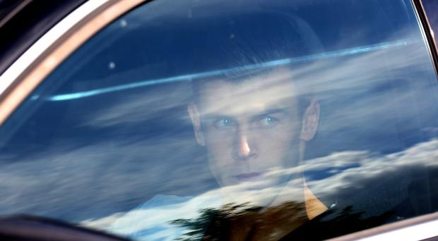 Tottenham Hotspurs' Gareth Bale (right) is driven away from Enfield Training Ground, North London. PRESS ASSOCIATION Photo. Picture date Monday August 5 2013. Photo credit should read: Chris Radburn/PA Wire.