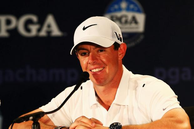 ROCHESTER, NY - AUGUST 07: Rory McIlroy of Northern Ireland is interviewed during a press conference prior to the start of the 95th PGA Championship at Oak Hill Country Club on August 7, 2013 in Rochester, New York. (Photo by Streeter Lecka/Getty Images)