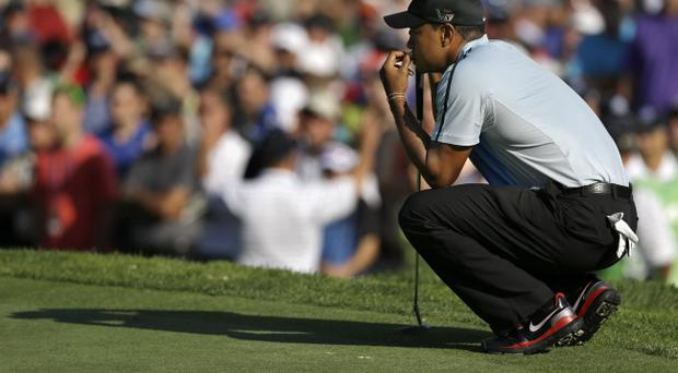 Tiger Woods lines up a putt on the first hole during the first round of the PGA Championship golf tournament at Oak Hill Country Club, Thursday, Aug. 8, 2013, in Pittsford, N.Y. (AP Photo/Patrick Semansky)