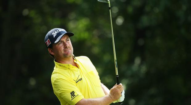 ROCHESTER, NY - AUGUST 08: Graeme McDowell of Northern Ireland watches his tee shot on the third tee during the first round of the 95th PGA Championship on August 8, 2013 in Rochester, New York. (Photo by Andrew Redington/Getty Images)