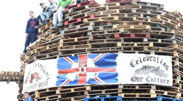 A loyalist banner been stolen from a wall in south Belfast and placed on a bonfire in the nearby nationalist Divis area. Photo by Pacemaker Belfast.