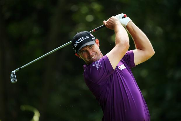 ROCHESTER, NY - AUGUST 08: Padraig Harrington of Ireland hits his tee shot on the third hole during the first round of the 95th PGA Championship on August 8, 2013 in Rochester, New York. (Photo by Andrew Redington/Getty Images)