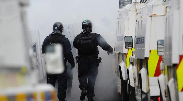 Loyalists protesters riot with police at Royal Avenue in Belfast City