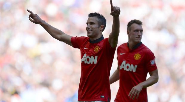 Manchester United's Robin van Persie celebrates scoring his second goal of the game during the Community Shield match at Wembley Stadium, London. Andrew Matthews/PA Wire.