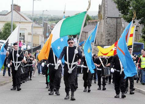 The parade as it made its way through Castlederg to remember IRA members who died during the Northern Ireland Troubles. Relatives of IRA victims held a church service and protest in the Co. Tyrone town. The commemoration parade rakes places every year but was to coincide in 2013 with the deaths of IRA volunteers Seamus Harvey and Gerard McGlynn who died in 1973 whilst transporting a bomb to Castlederg which prematurely exploded. Photo-Jonathan Porter/Presseye.