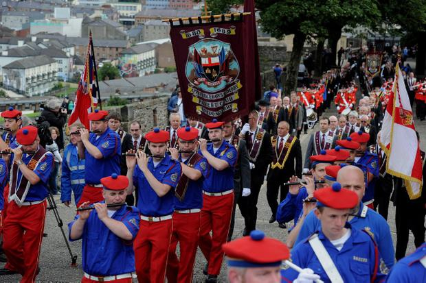 Apprentice Boys of Derry and bandsmen on parade around Derry Walls on traditional Relief of Derry celebrations in the city. Photo Trevor McBride