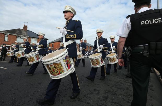 Apprentice Boys of Derry and loyalist marching bands pass by Republican protestors at Ardoyne shops in north Belfast during a parade. Picture by Kelvin Boyes / Press Eye.