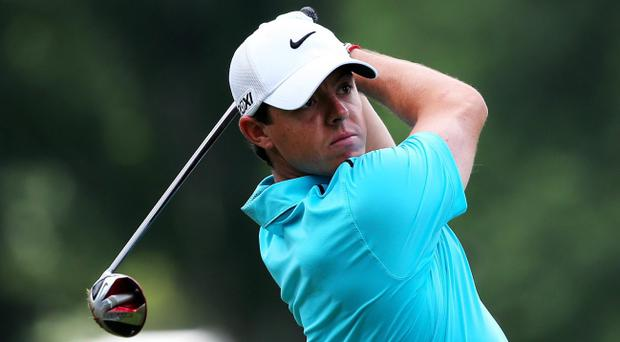 ROCHESTER, NY - AUGUST 11: Rory McIlroy of Northern Ireland hits his tee shot on the second hole during the final round of the 95th PGA Championship on August 11, 2013 in Rochester, New York. (Photo by Rob Carr/Getty Images)