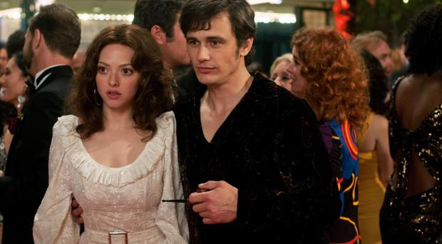 This film publicity image released by RADIUS-TWC shows Amanda Seyfried as Linda Lovelace, left, and James Franco as Hugh Hefner in