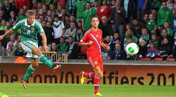 Northern Ireland Jamie Ward fires a shot on goal against Russia