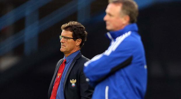 Fabio Capello (left) and Michael O'Neill during Wednesday night's match at Windsor Park