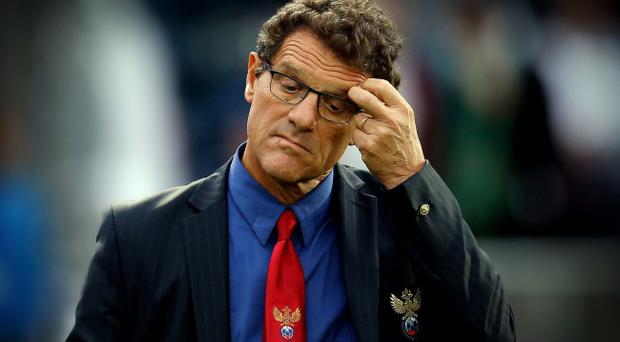 Russia manager Fabio Capello is dejected after being defeated 1-0 during the 2014 FIFA World Cup Qualifier against Northern Ireland at Windsor Park