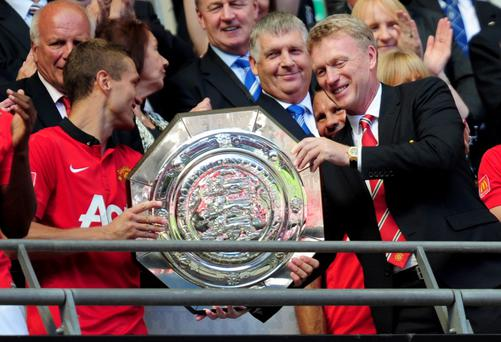LONDON, ENGLAND - AUGUST 11: Nemanja Vidic of Manchester United and manager David Moyes with the trophy after victory in the FA Community Shield match between Manchester United and Wigan Athletic at Wembley Stadium on August 11, 2013 in London, England. (Photo by Jamie McDonald/Getty Images)