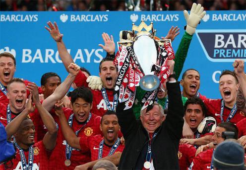 Sir Alex Ferguson lifts the Premier League trophy following the Barclays Premier League match between Manchester United and Swansea City at Old Trafford (Alex Livesey/Getty Images)