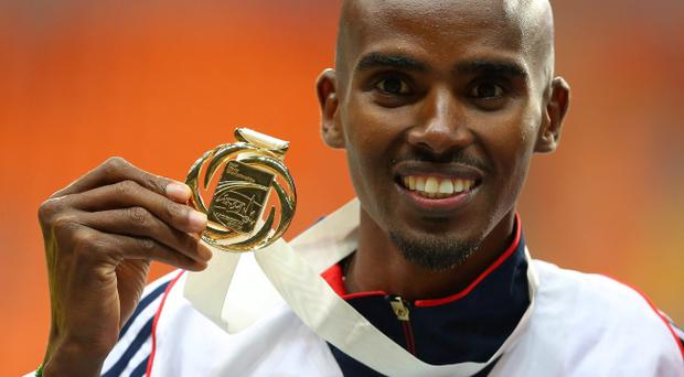Great Britain's Mo Farah poses with his gold medal after winning the Men's 5000 metres during day seven of the 2013 IAAF World Athletics Championships at the Luzhniki Stadium in Moscow, Russia.