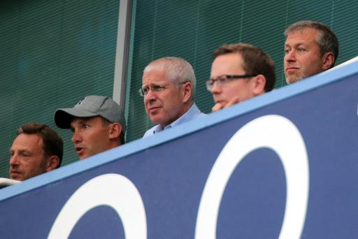 Chelsea's owner Roman Abramovich (right) and former player Andriy Shevchenko (second left) in the stands during the Barclays Premier League match at Stamford Bridge, London