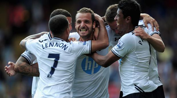 LONDON, ENGLAND - AUGUST 18: Roberto Soldado of Tottenham Hotspur (C) celebrates scoring from the penalty spot with team mates during the Barclays Premier League match between Crystal Palace and Tottenham Hotspur at Selhurst Park on Augsut 18, 2013 in London, England. (Photo by Jamie McDonald/Getty Images)
