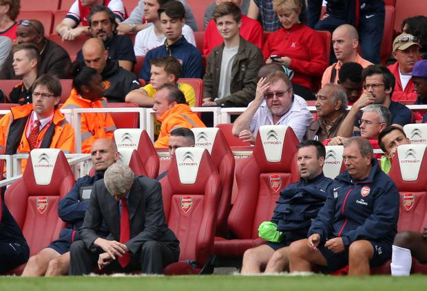 Arsenal's manager Arsene Wenger (centre) looks dejected during his team's 3-1 defeat to Astron Villa on Saturday