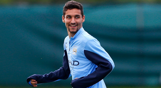 MANCHESTER, ENGLAND - AUGUST 16: Jesus Navas of Manchester City smiles during a Manchester City open training session at their Carrington Training Complex on August 16, 2013 in Manchester, England (Photo by Paul Thomas/Getty Images)