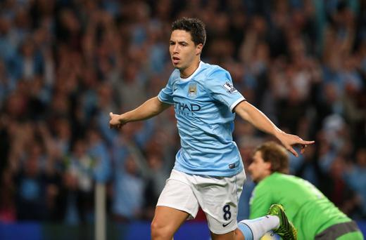 MANCHESTER, ENGLAND - AUGUST 19: Samir Nasri of Manchester City celebrates scoring the fourth goal during the Barclays Premier League match between Manchester City and Newcastle United at the Etihad Stadium on August 19, 2013 in Manchester, England. (Photo by Clive Brunskill/Getty Images)