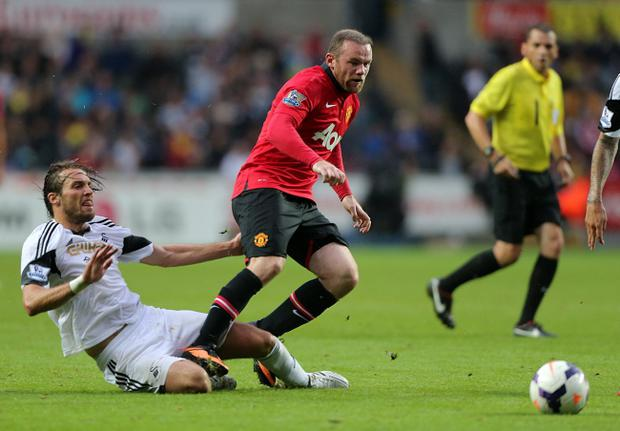 Wayne Rooney in action for Manchester United on Saturday, against Swansea City's Michu