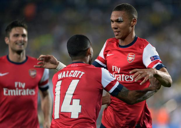 Arsenal's players celebrate after they scored a second goal during their Champions League qualifying playoffs, first leg soccer match with Fenerbahce at Sukru Saracoglu Stadium in Istanbul, Turkey, Wednesday, Aug. 21, 2013.(AP Photo)