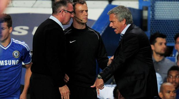 LONDON, ENGLAND - AUGUST 21: (L-R) Paul Lambert the Aston Villa manager and Jose Mourinho the Chelsea manager clash during the Barclays Premier League match between Chelsea and Aston Villa at Stamford Bridge on August 21, 2013 in London, England. (Photo by Jamie McDonald/Getty Images)